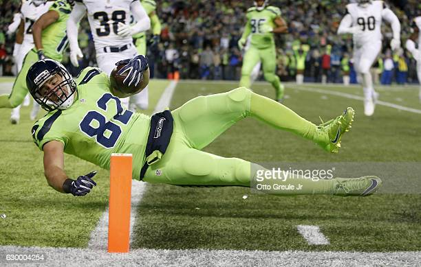 Tight end Luke Willson of the Seattle Seahawks scores a touchdown against the Los Angeles Rams at CenturyLink Field on December 15 2016 in Seattle...