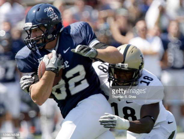 Tight end Luke Wison of the Rice Owls is tackled by Nnamdi Ezenwahe of the Purdue Boilermakers on September 10 2011 at Rice Stadium in Houston Texas