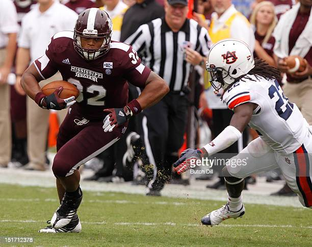 Tight end Marcus Green of the Mississippi State Bulldogs catches a pass and gets around defensive back Tsharvan Bell of the Auburn Tigers for a...