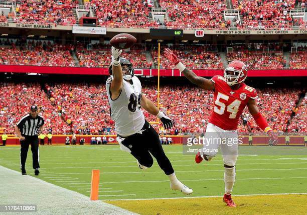Tight end Mark Andrews of the Baltimore Ravens can't reach a pass on the goal line as outside linebacker Damien Wilson of the Kansas City Chiefs...
