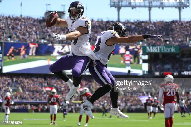 Tight end Mark Andrews of the Baltimore Ravens celebrates after scoring a touchdown against the Arizona Cardinals during the first quarter at M&T...