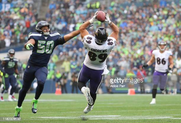 Tight end Mark Andrews of the Baltimore Ravens completes a reception against outside linebacker KJ Wright of the Seattle Seahawks in the second...