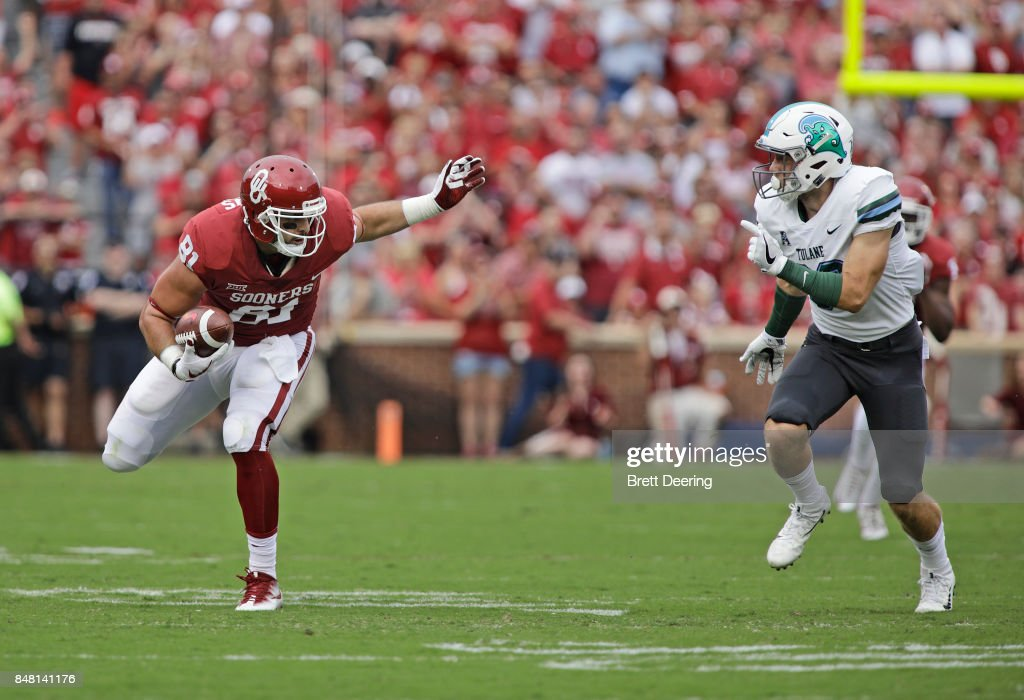 Tight end Mark Andrews #81 of the Oklahoma Sooners looks to get around safety Chase Kuerschen #36 of the Tulane Green Wave at Gaylord Family Oklahoma Memorial Stadium on September 16, 2017 in Norman, Oklahoma. Oklahoma defeated Tulane 56-14.