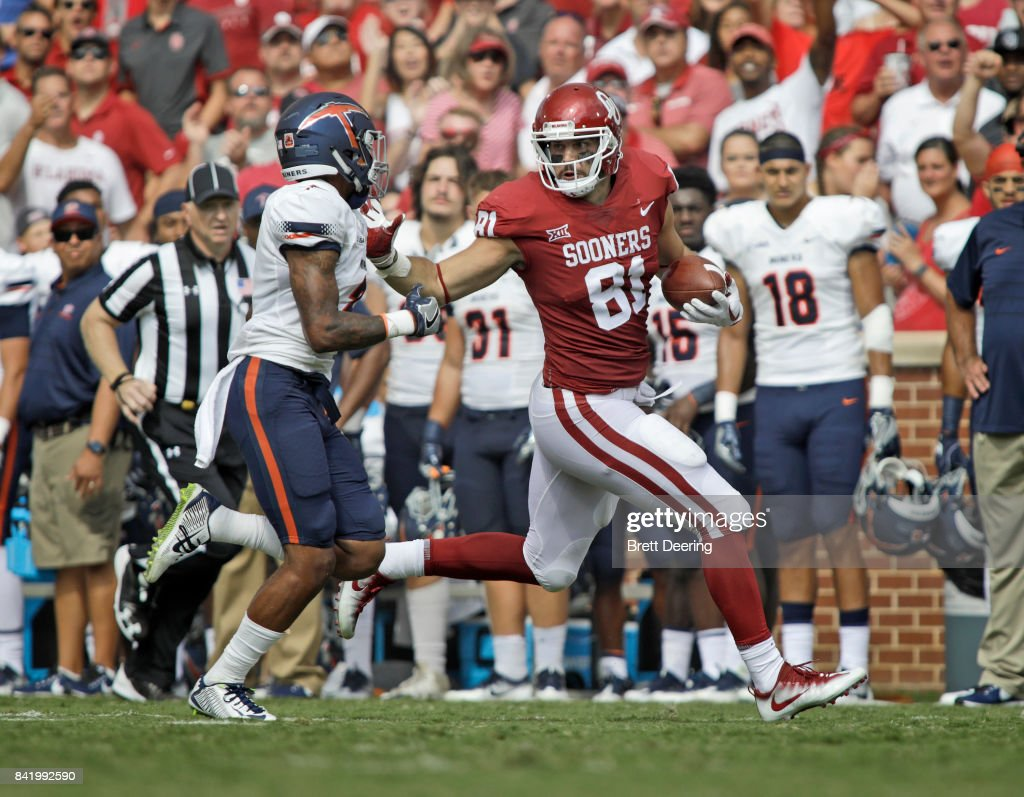 Tight end Mark Andrews #81 of the Oklahoma Sooners stiff arms defensive back Michael Lewis #2 of the UTEP Miners at Gaylord Family Oklahoma Memorial Stadium on September 2, 2017 in Norman, Oklahoma. Oklahoma defeated UTEP