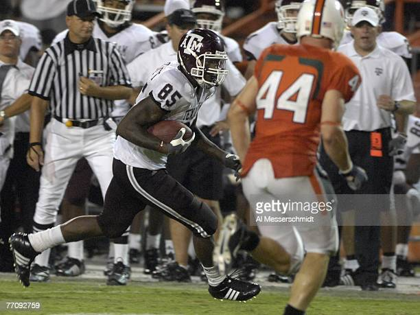 Tight end Martellus Bennett of Texas AM Aggies rushes upfield against the University of Miami Hurricanes at the Orange Bowl on September 20 2007 in...