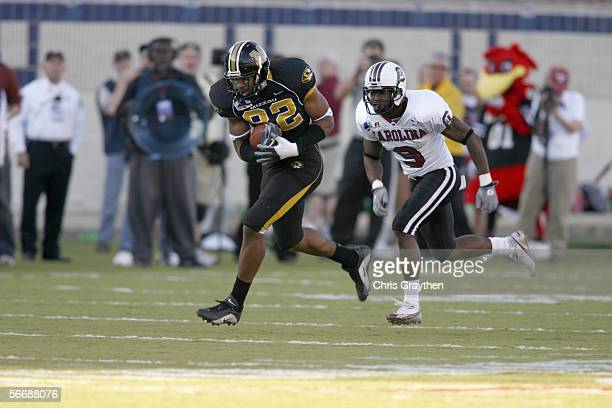 Tight end Martin Rucker of the Missouri Tigers carries the ball against defensive back Johnathan Joseph of the South Carolina Gamecocks during the...