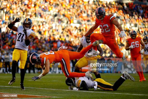 Tight end Matt LaCosse of the Denver Broncos dives into the end zone with a second quarter touchdown against the Pittsburgh Steelers at Broncos...