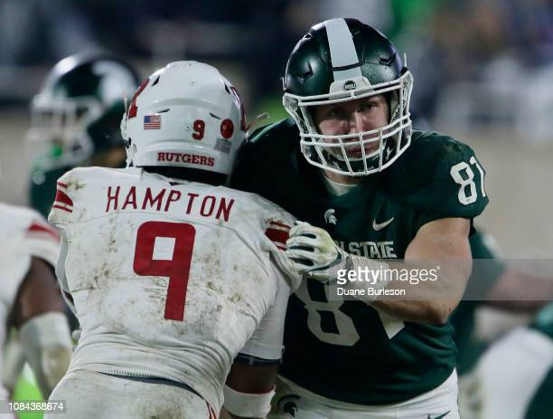 Tight end Matt Sokol of the Michigan State Spartans blocks defensive back Saquan Hampton of the Rutgers Scarlet Knights during the second half at...