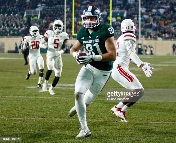 Tight end Matt Sokol of the Michigan State Spartans scores against the Rutgers Scarlet Knights on a touchdown reception during the second quarter at...