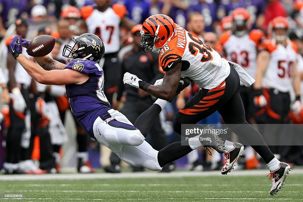 Tight end Maxx Williams #87 of the Baltimore Ravens cannot make a catch in front of strong safety Shawn Williams #36 of the Cincinnati Bengals on a fourth down conversation in the fourth quarter at M&T Bank Stadium on September 27, 2015 in Baltimore, Maryland.