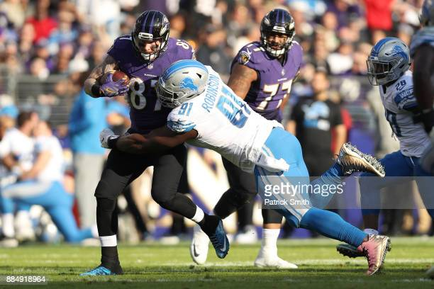 Tight End Maxx Williams of the Baltimore Ravens runs with the ball as he is tackled by defensive tackle A'Shawn Robinson of the Detroit Lions at MT...