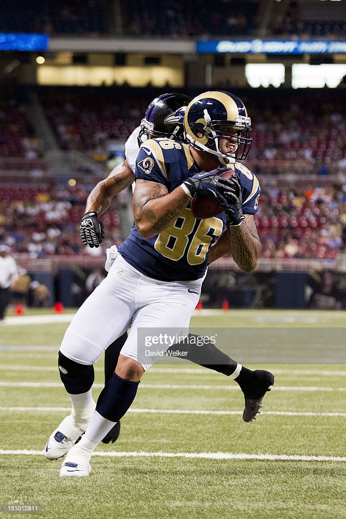 Tight end Michael Hoomanawanui #86 of the St. Louis Rams catches a throw in the end zone for a touchdown during the game against the Baltimore Ravens at the Edward Jones Dome on August 30, 2012 in St. Louis, Missouri.