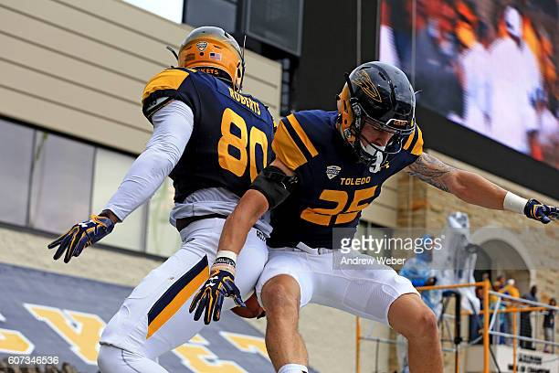 Tight end Michael Roberts and Cody Thompson of the Toledo Rockets celebrate after a touchdown during the first quarter against Fresno State Bulldogs...