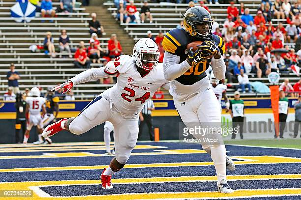 Tight end Michael Roberts of the Toledo Rockets catches a pass for a touchdown against defensive back Tank Kelly of the Fresno State Bulldogs during...