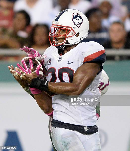 Tight end Mitchell Wilcox of the South Florida Bulls catches a pass behind safety Obi Melifonwu of the Connecticut Huskies for a touchdown during the...