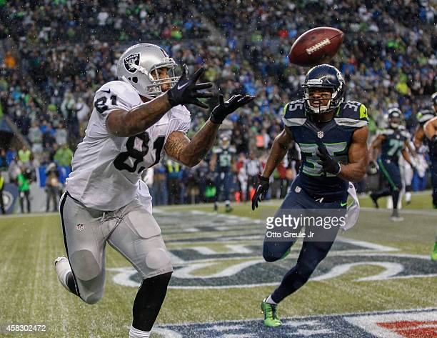 Tight end Mychal Rivera of the Oakland Raiders makes a touchdown catch in the fourth quarter against strong safety DeShawn Shead of the Seattle...