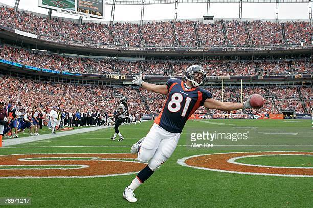 Tight end Nate Jackson of the Denver Broncos celebrates scoring a touchdown during the second quarter against the Jacksonville Jaguars during week...