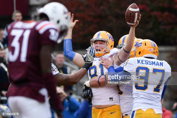 Tight end Nathan Bossory of the Pittsburgh Panthers scores a touchdown on a trick play against the Virginia Tech Hokies in the second half at Lane...