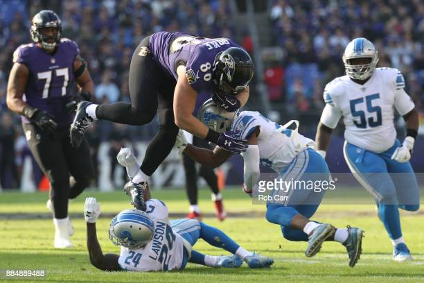 Tight End Nick Boyle of the Baltimore Ravens is tackled as he carries the ball by cornerback Quandre Diggs of the Detroit Lions in the first quarter...