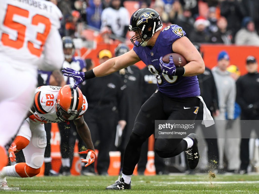 Tight end Nick Boyle #86 of the Baltimore Ravens stiff-arms safety Derrick Kindred #26 of the Cleveland Browns, as he carries the ball downfield in the first quarter of a game on December 17, 2017 at FirstEnergy Stadium in Cleveland, Ohio. Baltimore won 27-10.