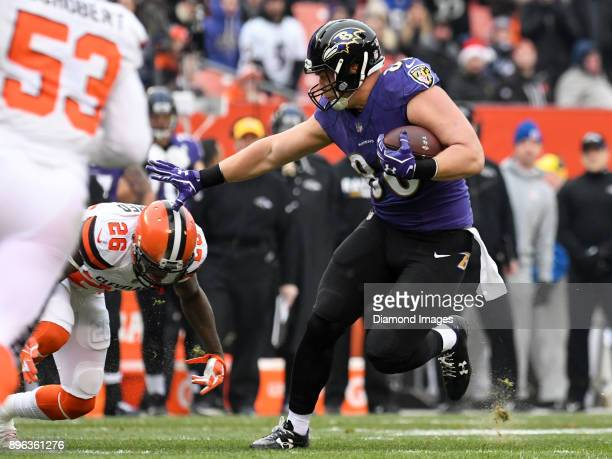 Tight end Nick Boyle of the Baltimore Ravens stiffarms safety Derrick Kindred of the Cleveland Browns as he carries the ball downfield in the first...