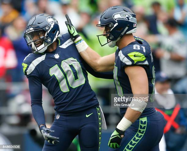 Tight end Nick Vannett of the Seattle Seahawks congratulates wide receiver Paul Richardson on his touchdown during the fourth quarter to give the...