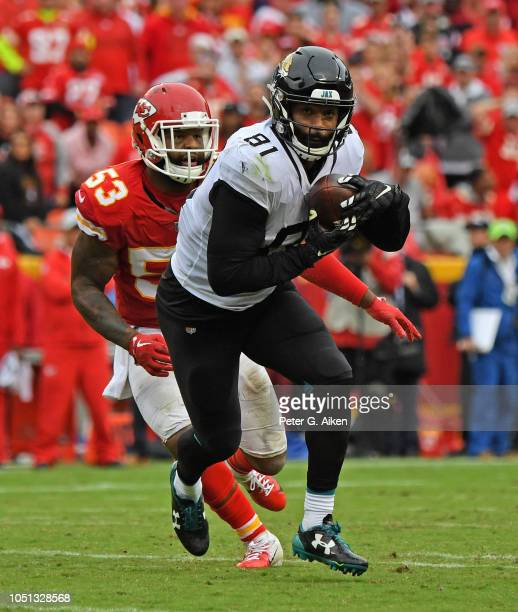 Tight end Niles Paul of the Jacksonville Jaguars catches a pass against linebacker Anthony Hitchens of the Kansas City Chiefs during the second half...