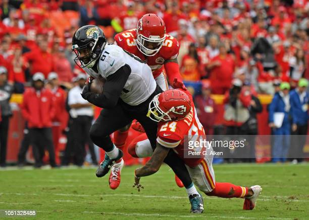 Tight end Niles Paul of the Jacksonville Jaguars gets tackled by linebacker Anthony Hitchens of the Kansas City Chiefs and defensive back Jordan...
