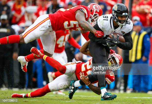 Tight end Niles Paul of the Jacksonville Jaguars ran after a fourth quarter pass catch while being tackled by linebacker Anthony Hitchens of the...