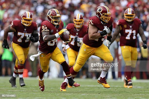 Tight end Niles Paul of the Washington Redskins carries the ball against the Dallas Cowboys in the third quarter at FedExField on September 18 2016...