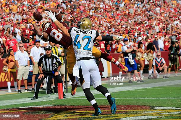 Tight end Niles Paul of the Washington Redskins catches a fourth quarter touchdown over strong safety Chris Prosinski of the Jacksonville Jaguars...