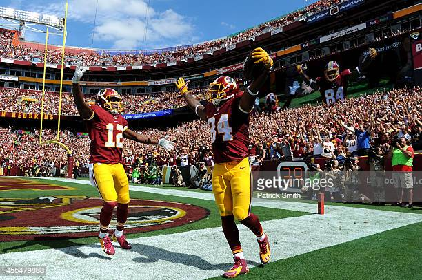 Tight end Niles Paul of the Washington Redskins celebrates after a long reception against the Jacksonville Jaguars in the first quarter at FedExField...