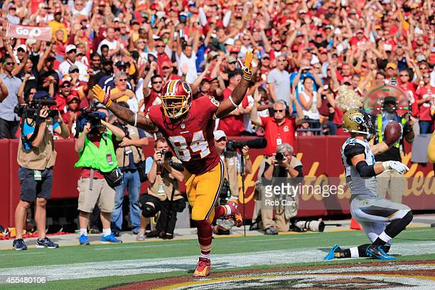 Tight end Niles Paul of the Washington Redskins celebrates after scoring a touchdown during the second half against the Jacksonville Jaguars at...