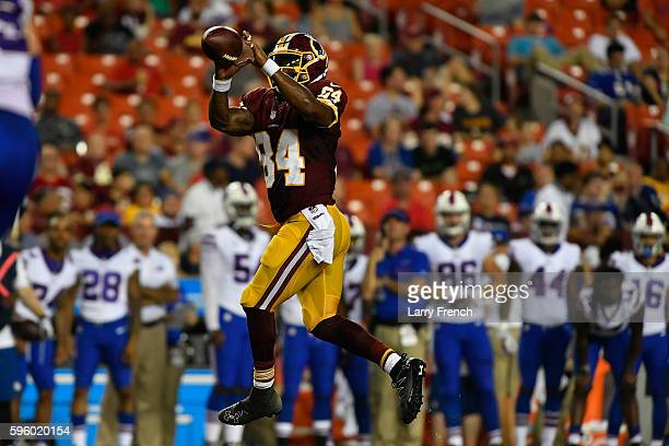 Tight end Niles Paul of the Washington Redskins makes a catch during the game between the Washington Redskins and the Buffalo Bills at FedExField on...