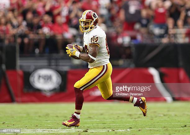 Tight end Niles Paul of the Washington Redskins runs with the football against the Arizona Cardinals during the NFL game at the University of Phoenix...