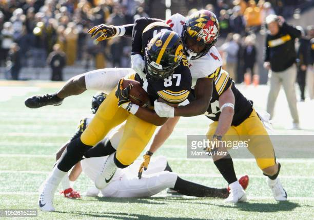 Tight end Noah Fant of the Iowa Hawkeyes is brought down during the first half by defensive back Darnell Savage of the Maryland Terrapins on October...