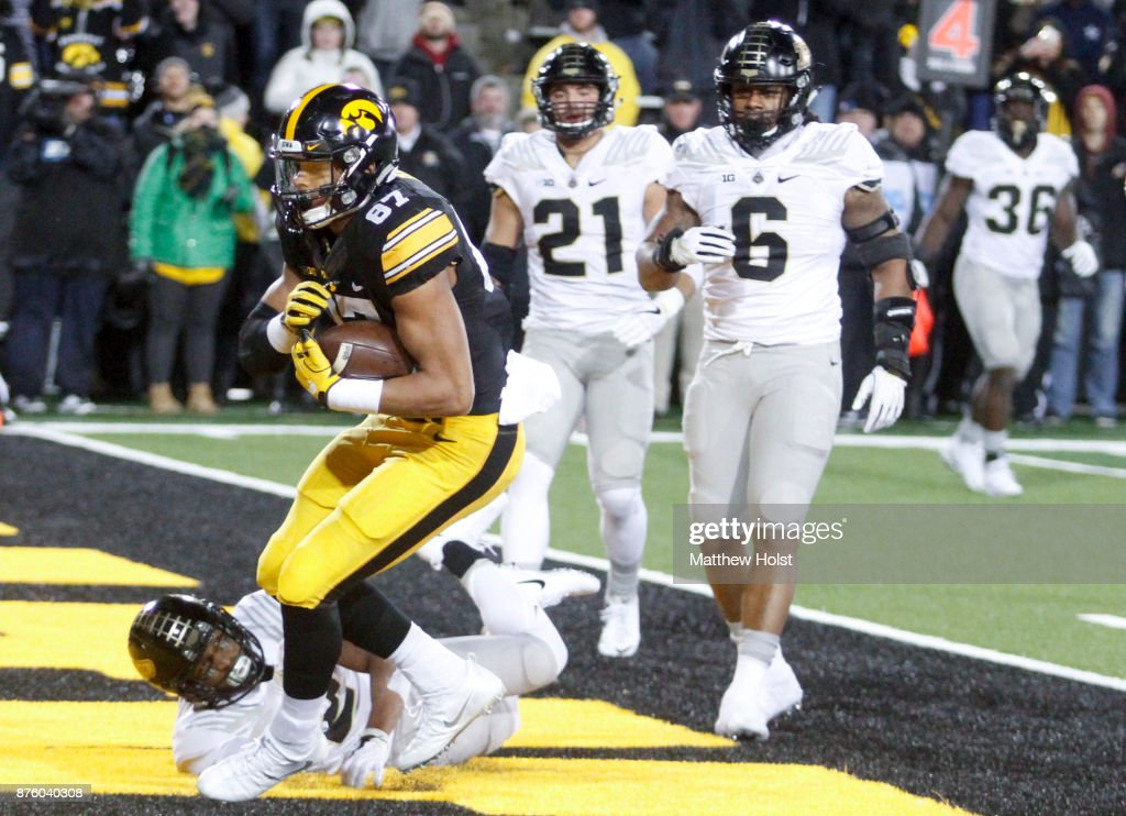 Tight end Noah Fant #87 of the Iowa Hawkeyes makes a touchdown reception during the fourth quarter in front of cornerback Da'Wan Hunte #2 of the Purdue Boilermakers on November 18, 2017 at Kinnick Stadium in Iowa City, Iowa.