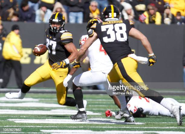 Tight end Noah Fant of the Iowa Hawkeyes runs up the field during the second half in front of defensive back Darnell Savage of the Maryland Terrapins...