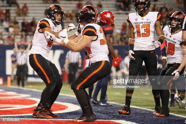 Tight end Noah Togiai of the Oregon State Beavers celebrates with running back Ryan Nall after Togiai scored on a 15 yard reception against the...