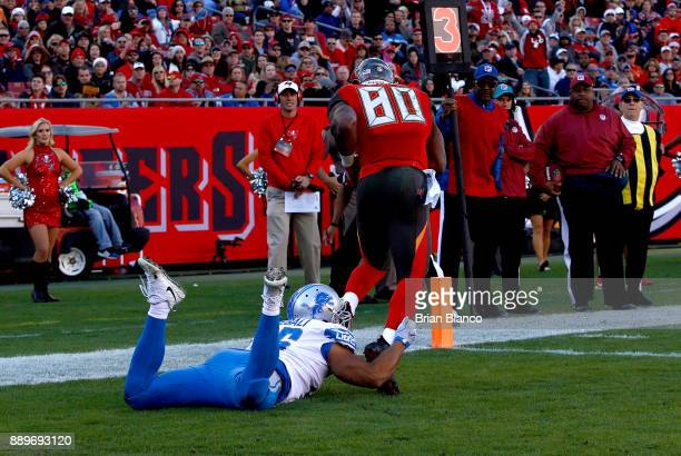 Tight end OJ Howard of the Tampa Bay Buccaneers is hit by linebacker Kasim Edebali of the Detroit Lions as he hauls in a 2yard pass by quarterback...