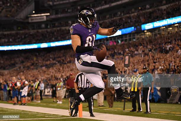 Tight end Owen Daniels of the Baltimore Ravens celebrates his touchdown against the Pittsburgh Steelers during 1st quarter at M&T Bank Stadium on...