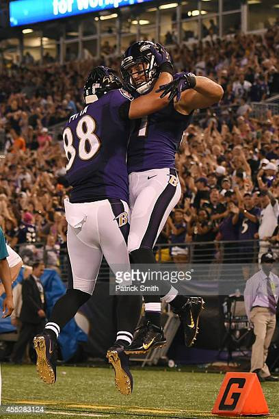 Tight end Owen Daniels of the Baltimore Ravens celebrates his touchdown with teammate Dennis Pitta against the Pittsburgh Steelers during 1st quarter...