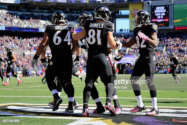 Tight end Owen Daniels of the Baltimore Ravens is congratulatd by teammates after scoring a first quarter touchdown against the Atlanta Falcons at MT...