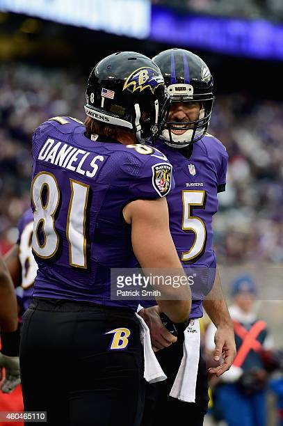 Tight end Owen Daniels of the Baltimore Ravens is congratulated by quarterback Joe Flacco after catchinga third quarter touchdown against the...
