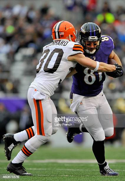 Tight end Owen Daniels of the Baltimore Ravens is tackled by free safety Jim Leonhard of the Cleveland Browns in the second quarter of a game at MT...