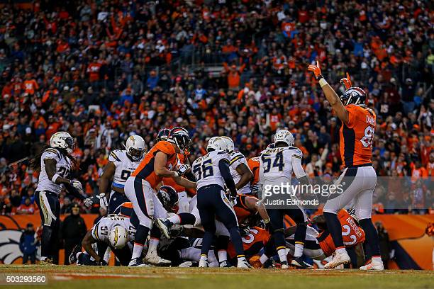 Tight end Owen Daniels of the Denver Broncos begins to celebrate as running back CJ Anderson of the Denver Broncos scores a touchdown on a 1yard rush...