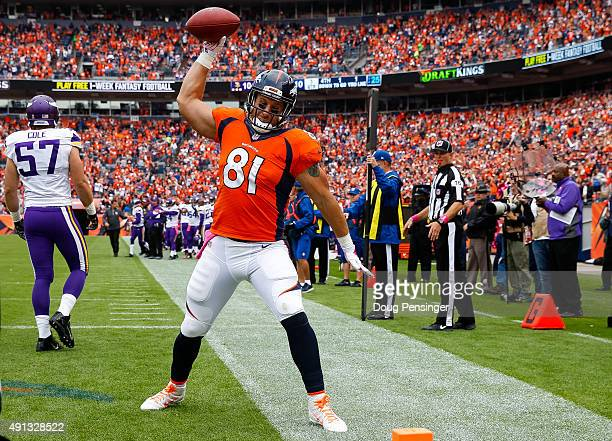 Tight end Owen Daniels of the Denver Broncos celebrates in the end zone after a second quarter passing play against the Minnesota Vikings during a...
