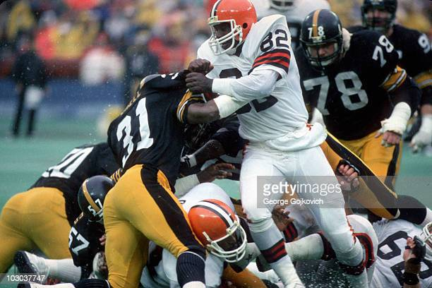 Tight end Ozzie Newsome of the Cleveland Browns blocks safety Donnie Shell of the Pittsburgh Steelers during a game at Three Rivers Stadium circa...