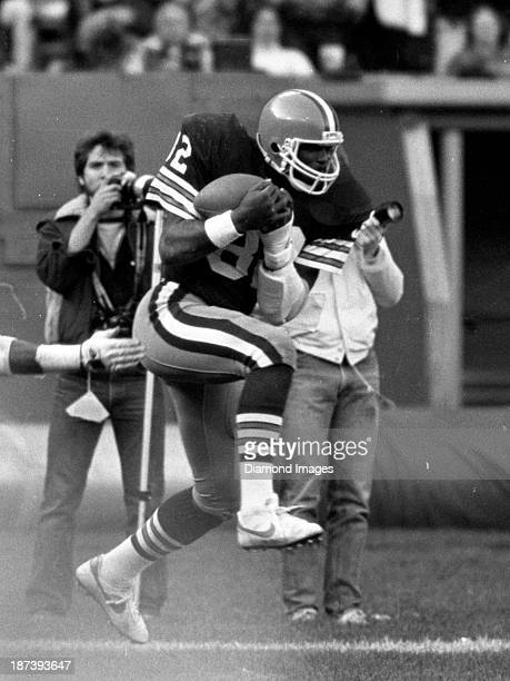 Tight end Ozzie Newsome of the Cleveland Browns catches a pass during a game against the Houston Oilers on October 30 1983 at the Cleveland Municipal...