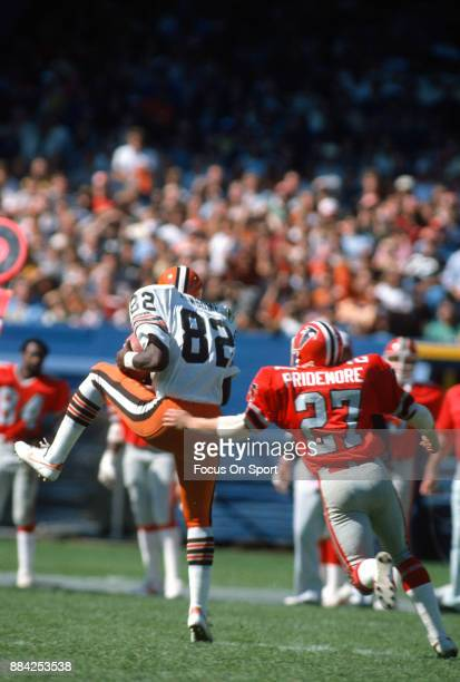 Tight End Ozzie Newsome of the Cleveland Browns catches a pass in front of Tom Pridemore of the Atlanta Falcons during an NFL football game September...